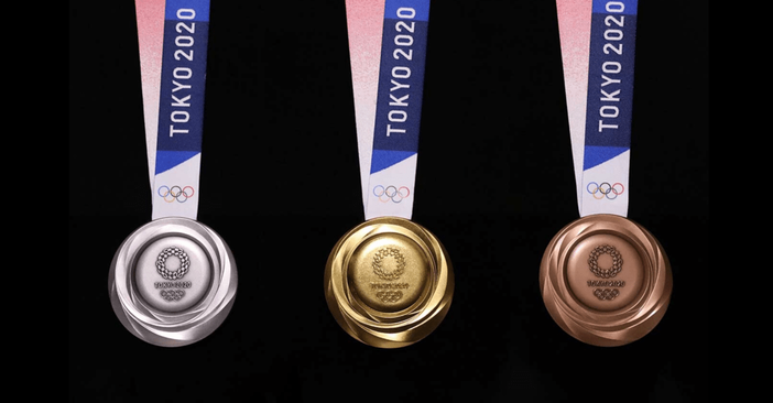 Three Olympic Medals from the Tokyo 2020 Olympic Games. From left to right: silver, gold and bronze medals.